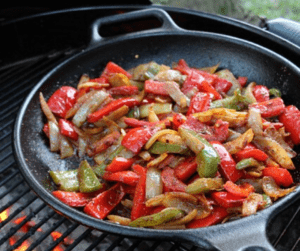 cooking with a cast iron skillet over a fire